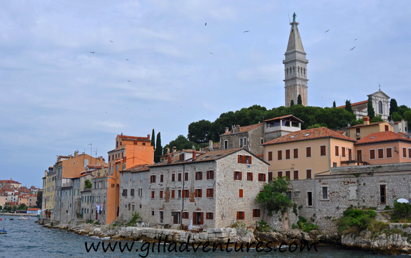 The old town of Rovinj juts out into the sea in the shape of a spoon. A narrow neck connects this little peninsula to the rest of town, in the center of the inverted bowl stands the church of St. Euphemia.