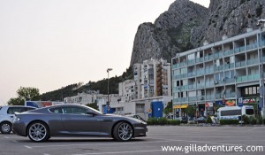 An Aston Martin, a car most people in the world cannot afford, in the parking lot in Omi, Croatia