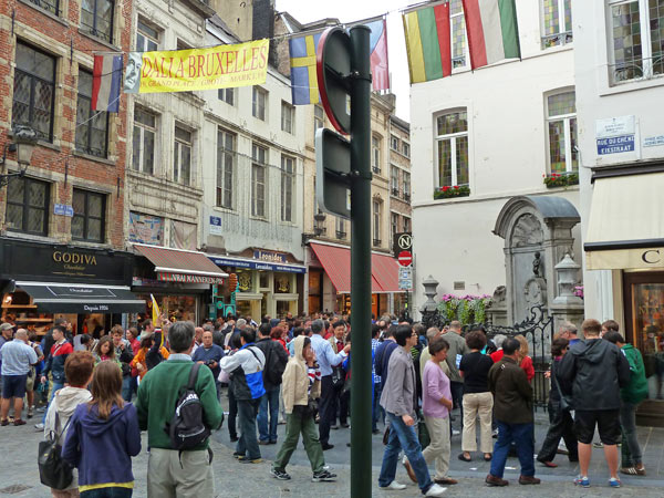 In Brussels, a constant crowd gathers in front of the small fountain statue called Manneken Pis, of a little boy peeing.