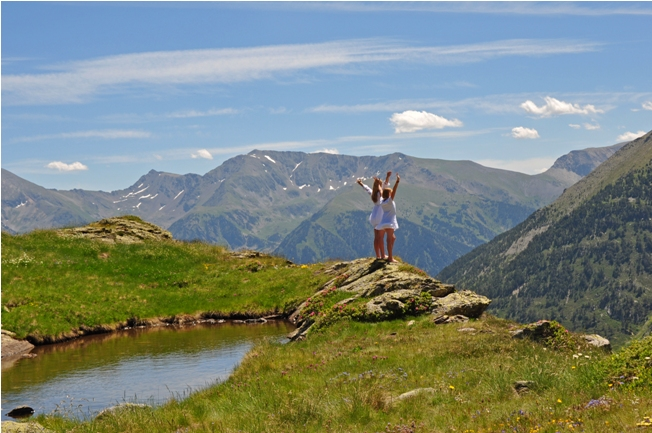 Girls in white dresses on a mountain top in Andorra