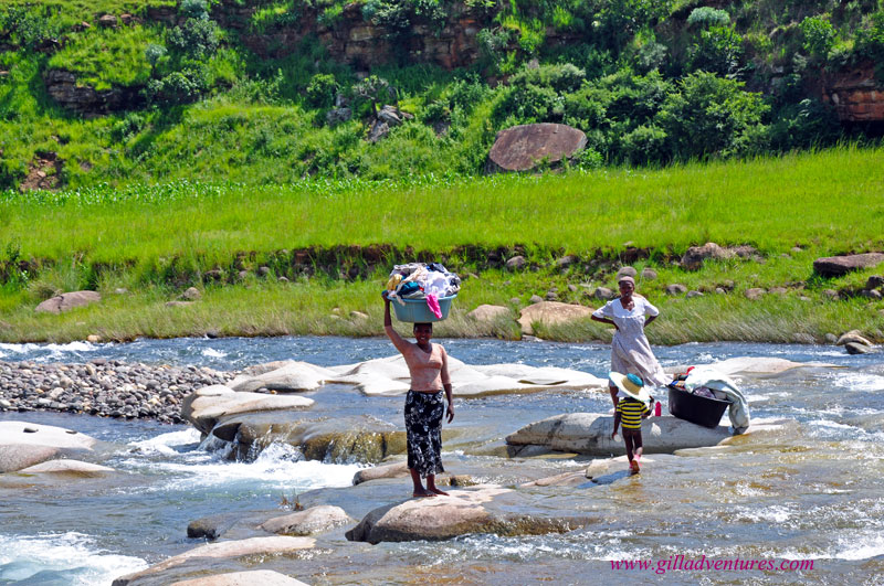 Women with their laundry in the river in KwaZulu Natal