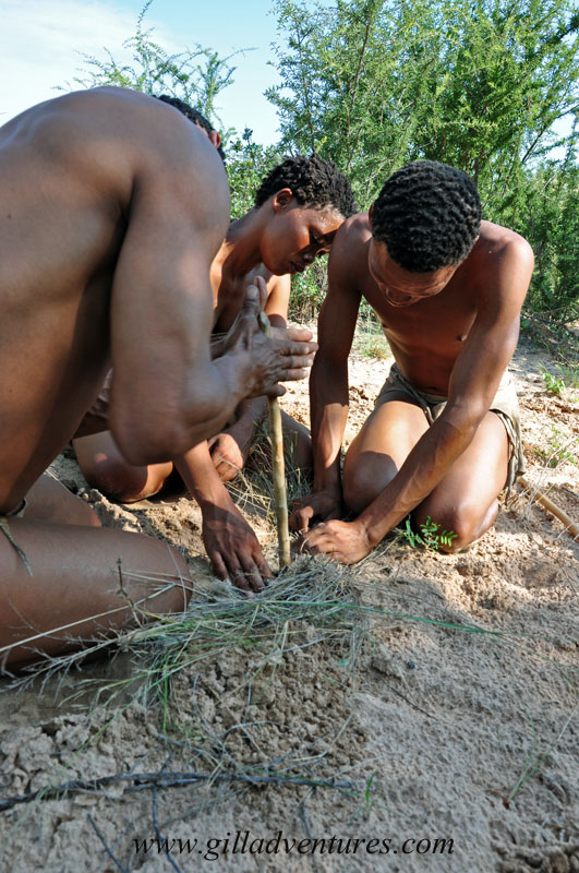 African San making fire by rubbing sticks together