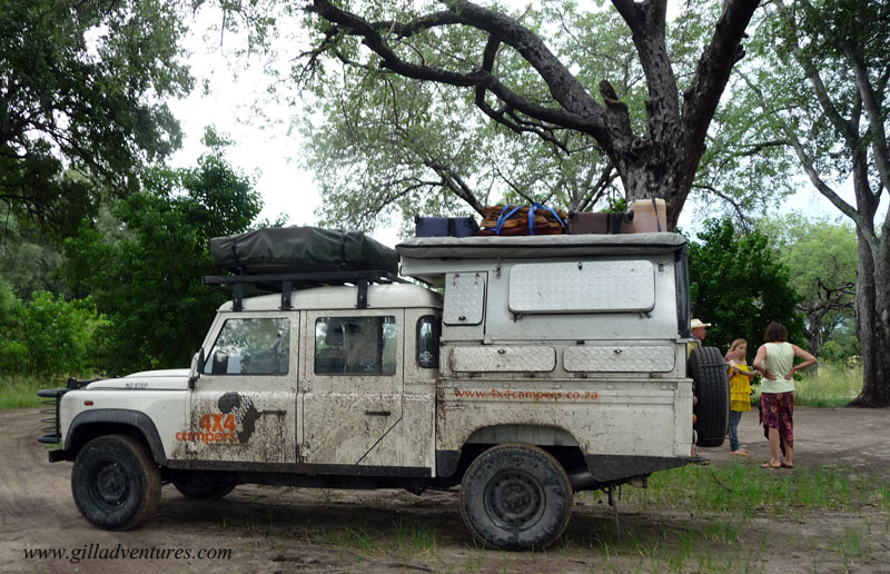 "Our Land Rover ""Grover"" covered in mud as we arrived in Xakanaxa Camp, Moremi Game Reserve, Okavango Delta, Botswana"