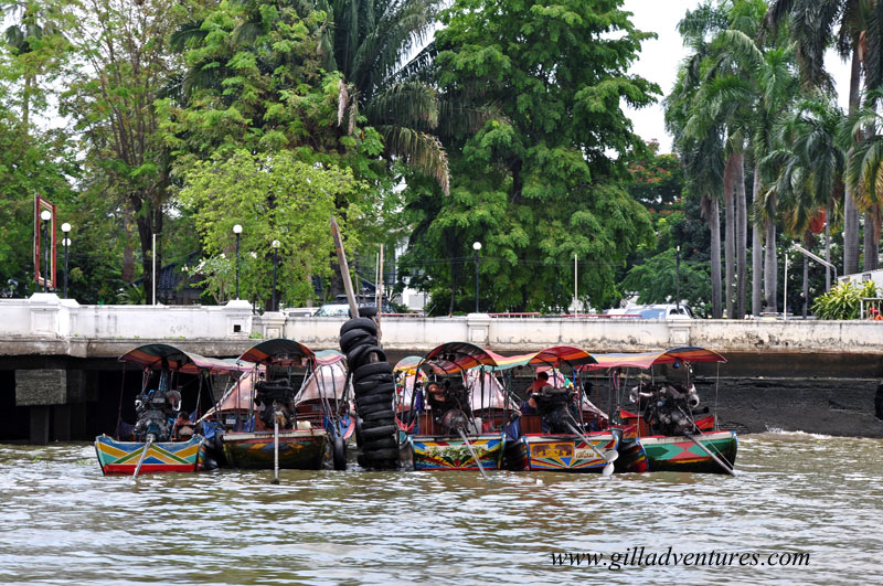 Longtail boats on the Chao Phraya River in Bangkok, Thailand