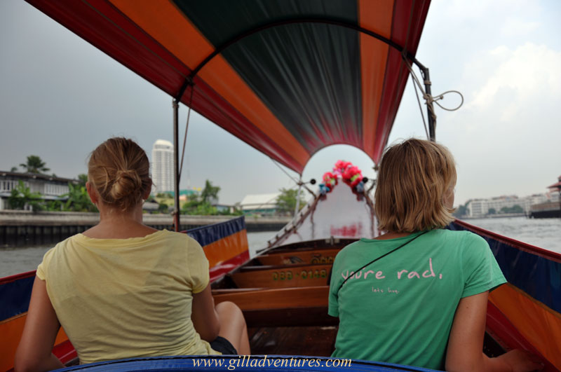 Riding in a longtail boat on the Chao Phraya River