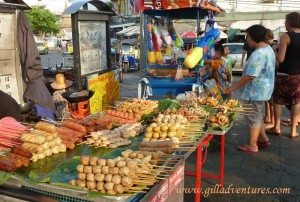 A street food cart and another selling water guns in Bangkok.