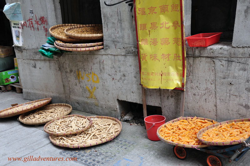 fruit drying on the side of the street in Hong Kong. Photo from our around the world travelogue.
