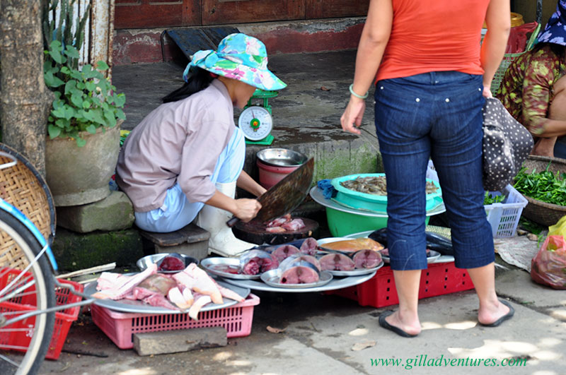 Fish monger, Hue, Vietnam. Photo taken on our trip around the world with our family, and posted to our travelogue.