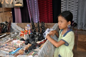 A young girl selling souvenirs in the Karen hill tribe village along the Thailand Myanmar border