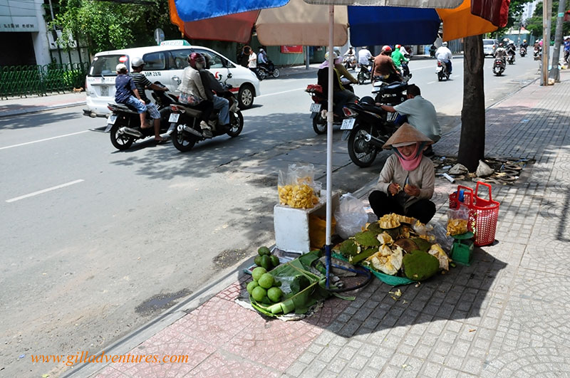 A woman selling jackfruit on the street in Ho Chi Minh City.