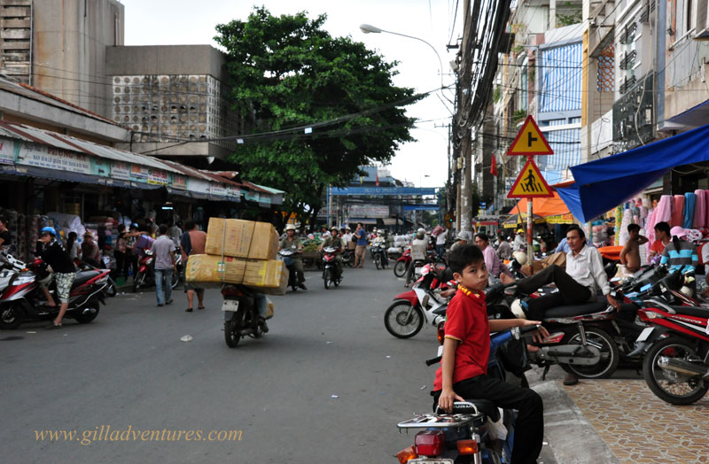 A motorbike carrying a huge load at the Tan Binh Market, Ho Chi Minh,, Vietnam. Image from our round the world travelogue.