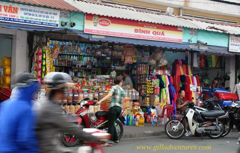 Colorful shops next to the Tan Binh Market, Ho Chi Minh City, Vietnam. Photo taken on our trip around the world, posted to our travelogue.